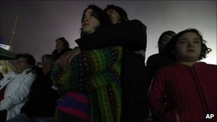 Relatives of the trapped miners watch the video (27 August 2010)