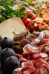 Image of fruit, cheese and cured meats