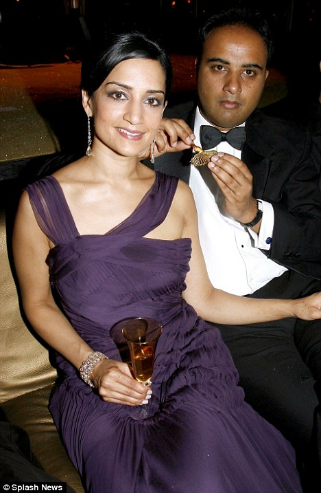 Arranged marriage: Archie Panjabi with husband Rajesh, a tailor