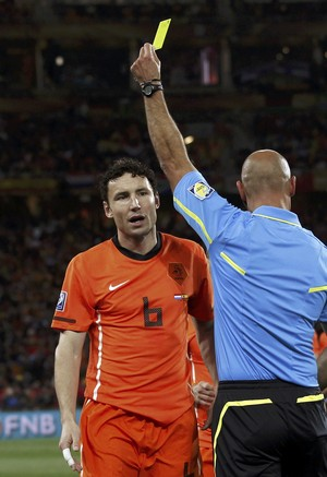 Referee Howard Webb of England shows the yellow card to Netherlands' Mark van Bommel during their 2010 World Cup final against Spain at Soccer City stadium in Johannesburg.