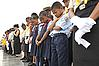 Children from the Seventh Day Adventist Youth Choir bow their heads in prayer during the invocation of ceremony commemorating the fifth anniversary of Hurricane Katrina in New Orleans, Sunday, Aug. 29, 2010.