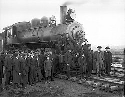 people standing beside a train