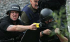 Armed police officers attempt to negotiate with Raoul Moat