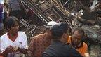 Rescuers at scene of rail accident at Petarukan