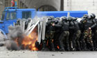 Riot police is attack by anti-government protesters in Bishkek