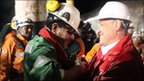 Luis Urzua is greeted by President Sebastian Pinera at the San Jose mine (13 October 2010)