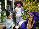From left to right: Rose and Sam Haberer - ages 2 and 6 - along with friend Clare Moore, 2, break into their tickle trunk.