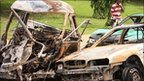 The burnt shells of cars after bombs exploded in Abuja, Nigeria, on Friday 1 October 2010.