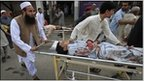 Victims of the bomb attack at a mosque in Darra Adam Khel are taken to Lady Reading Hospital in Peshawar for treatment November 5, 2010.