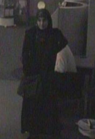 Determined: A ghostly CCTV image of Choudhry walking into see Mr Timms wirh her hand, holding the knife, concealed in bag