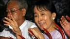 Aung San Suu Kyi waves at her supporters in Rangoon (13 November 2010)
