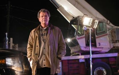 "Walter (John Noble) unearths clues to a case in the ""6955 kHz"" episode of FRINGE"