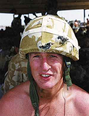 Royal Marine Eric Walderman in the kevlar helmet that saved his life. Photo: Via UK MoD.