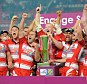 Delight: Wigan players celebrate their Grand Final win over St Helens last month