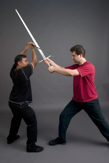 Sword fighter Jonathan Mayshar tries to overpower Seth Halsell