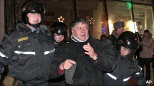 Protester is detained by riot police in Minsk