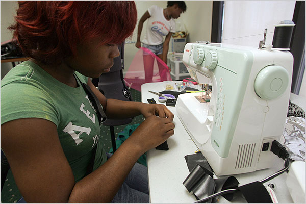 Serenthia Joseph, 17, works on a headband that will be featured in a June 17 fashion show produced by the Fashion Institute of New Orleans. Joseph said she began to learn how to sew the day before. (Thaisi H. Da Silva/NYT Institute)