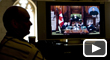 A member of the media watches question period on a television in the foyer of the House of Commons in Ottawa, on Tuesday, Dec. 2, 2008. (Adrian Wyld / THE CANADIAN PRESS)