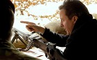 Prime Minister David Cameron surveys a nearby village from the top of a sangar observation point in Afghanistan