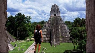 A traveller takes in the sites of the Mayan pyramids of Tikal, Guatamala