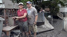 Wendy Schultz and Darren Hawkins outside their flooded home