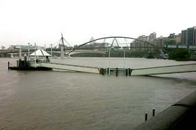 The Brisbane River swamps one of the ferry pontoons at Southbank