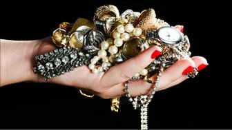A hand holding jewellery