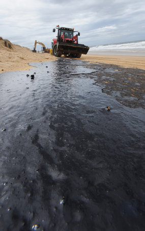 Oil has caked about 60 kilometres of beaches along the coast.
