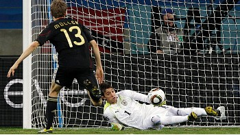 Thomas Muller slots the ball past Fernando Muslera