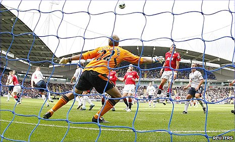 Man Utd striker Michael Owen (left) glances in a header to draw his side level at Bolton