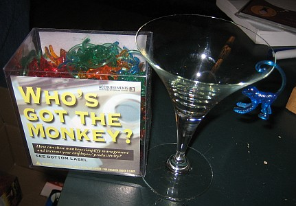 Picture of Box of Cocktail Monkeys and a Martini Glass with a blue one hanging from the martini glass rim