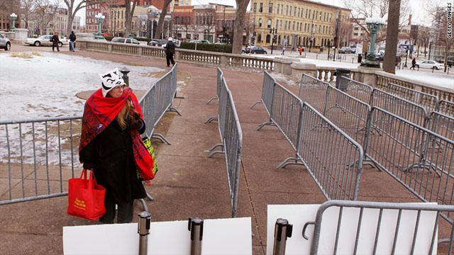 Gloria Hays waits to enter the capitol on Thursday in Madison, Wisconsin. Police are allowing one protester to enter the capitol for every protester that leaves.