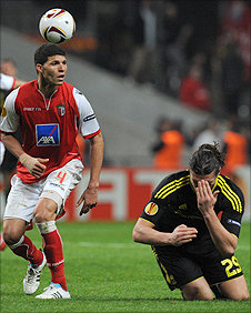 Liverpool striker Andy Carroll (right) goes to ground after being caught by the elbow of Braga defender Kaka