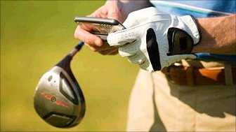 A golfer with a mobile phone