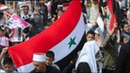 Protesters in support of Syrian President Assad
