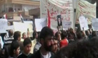 Anti-government demonstrators march in Daraa, Syria