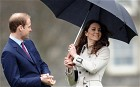 Prince William (L) accompanied by his fiancee Kate Middleton,