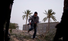 A rebel fighter runs for cover in Misrata