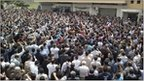 Protesters shout slogans during a demonstration after Friday prayers in the Syrian port city of Baniyas on 29 April 2011