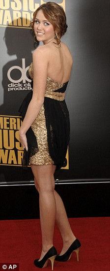 Miley Cyrus arrives at the American Music Awards
