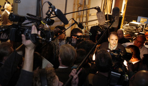 David Axelrod is surrounded by media representatives as he works on behalf of Barack Obama after the Iowa debate this month.