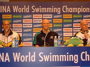 Australian 4 x 100 Free relay swimmers at the post race interview. Michael Klim in the center.