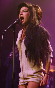 Amy Winehouse : 6 Grammy nominations, and a gift for public self-destruction.