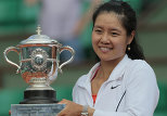 China's Li Na holds the trophy after winning over Italy's Francesca Schiavone during their Women's final in the French Open tennis championship