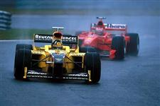 Spa, August 1998: Race winner Damon Hill holds off the Ferrari of Michael Schumacher early in the Belgian Grand Prix. Hill went on to take victory, his first for Jordan, and the last of his Formula One career. © Sutton