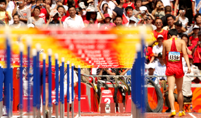 China's Liu Xiang leaves Beijing's National Stadium with a foot injury on Monday.