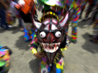 A member of the Dancing Devils of Naiguata dramatize the struggle between good and evil during Corpus Christi celebrations in Naiguata, outskirt of Caracas, June 23, 2011.