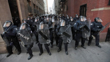 Riot police move through a downtown alley during the G20 summit in Toronto on June 25, 2010. - Riot police move through a downtown alley during the G20 summit in Toronto on June 25, 2010. | Mark Blinch/Reuters