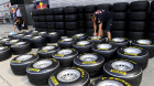 Technicians from Red Bull Racing team prepare the tires at the Shanghai International Circuit on April 14, 2011, ahead of the 2011 Formula One Chinese Grand Prix.