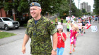 Major Pete Saunders leads a group of children on parade during a nieghbourhood block on his street in Ottawa. Major Saunders is in the Air Force and performs citizenship ceremonies regularly.